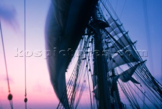 Four-masted barque Nippon Maru in a dawn breeze.