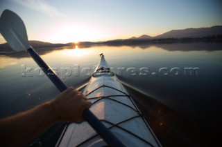 Woods Wheatcroft paddles out on Lake Pend Oreille in Sandpoint Idaho.  Photographing the fall colors in North Idaho.