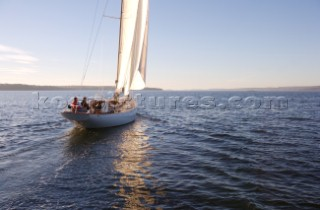 View of the yacht Anna, a 56 foot Spirit of Tradition class sloop, designed by Sparkman & Stephens being taken out for a sunset sail off the coast of Maine.  (release code: RP08004, RM08003, RM08004)