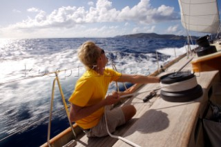 A crewmate tightens a line onboard the W-Class yacht Wild Horses, St. Bartholomew, French West Indies. (releasecode: RP08003, RM08005)
